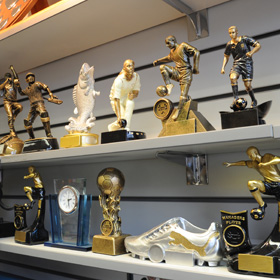 A selection of trophies on a shelf